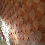 Textural wall going into the dining room, one of many little touches to the place