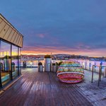 A magical view from the spacious roof terrace with seating areas and a view of the city, the