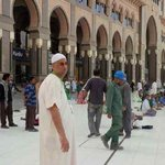 that is me in front of the hotel facing the Masjid-Al-Haram