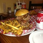 The large pulled-pork sandwich with a can of coke for scale.