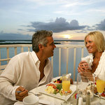 Couple at breakfast on balcony
