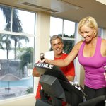 The Fitness Center features views of the pool and bay.