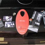 Room keys, Now/ Not Now  door hanger, TV List, and Remote