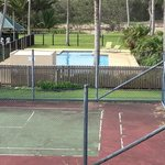 Tennis court tired but swimming pool in good condition