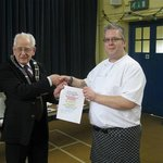 Gareth (right) receives his award for his entry to the Best Cawl in St Davids from The Mayor