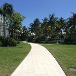 Path between the sandy area walking toward the pool and Butterfly Cafe