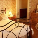 Rooms 9 & 10 have a queen and a single bed and access to the front/back veranda.