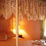 Room11 has an ensuite and a four poster queen bed.