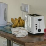 microwave toaster kettle electric hob and oven.  Dining area to fit  6 to 8 people.