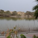 View from balcony across lagoon to the sand dunes