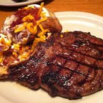 Bone in rib eye with loaded baked potato