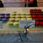 Macarons displayed in glass case