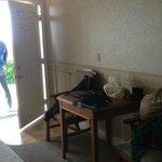 Room 104: Desk and patio door