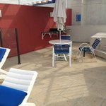 Rooftop spa area - very dirty and untidy with broken furniture