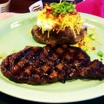 Texas Ribeye with loaded baked potato
