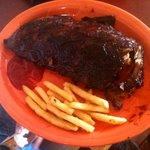 plate of munched on rack of ribs and half eaten fries :) too good to resist