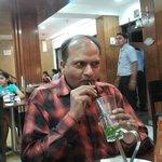 at dining enjoying green apple mojito