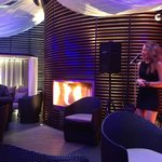 The outdoor cigar lounge with live singing and a fire