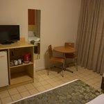 desk and fridge in room
