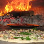 Pizza cooking in our wood burning oven