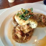 Blackened grouper over green fried tomatoes, topped with craw-fish and creamy creole sauce