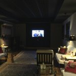 Communal area with big screen TV and piano