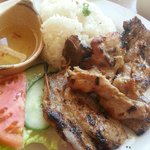 Grilled chicken, pork chop steamed rice served with salad, cucumber, tomato, fish sauce & beef s