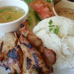 Grilled chicken steamed rice served with salad, cucumber, tomato, fish sauce and beef soup