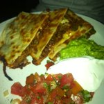 pulled pork quesadillas (minus one slice because someone couldn't wait to taste the goodness)