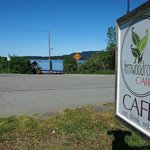 The Fernwood Road Cafe has a sign on the street. The sign is about three feet square.