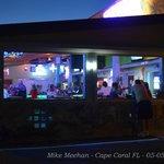 Outside bar at night.