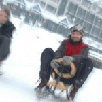 Experience the thrills of sledging down a snowy, traffic-free road