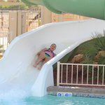 wife enjoying the slide at the pool