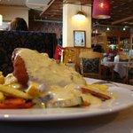 Фирменное блюдо - свинина под грибным соусом