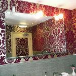 Flock wallpaper on the door of the loo!