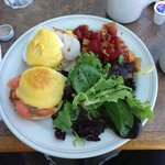 Eggs benedict florentine and neptune with home fries and salad