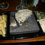 Tuna steak cooked on lava rock