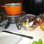 cheese fondue with fruit and bread