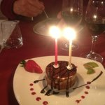 triple chocolate dessert  with birthday candles