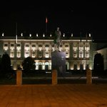 The palace by night.