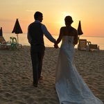 Just married..... A romantic walk on the beach before dinner