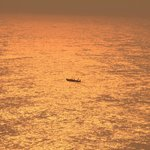 A tiny boat & the fiery sun. :)
