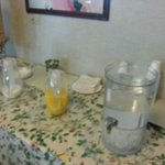 Cereal Table with orange juice, milk and water