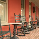 Front porch of the Atlantic Hotel with Rocking Chairs