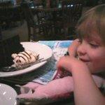 Granddaughter enjoying her Birthday Cake at Smokey Bones!