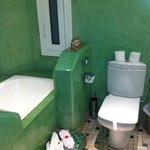 our bathroom. green stone walls.
