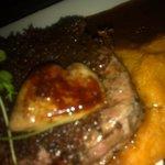 Beef fillet With Kalahari truffles, duck foie gras, smoked potato mash & dark red wine sauce