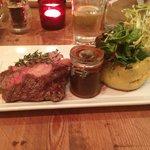 Rib-eye steak with chorizo mash and smoky jus.