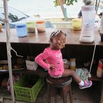 Adorable little girl at the Smoothie stand in front of Cindy's Place