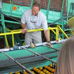 The owner, Jeff, checking out the citrus being washed
